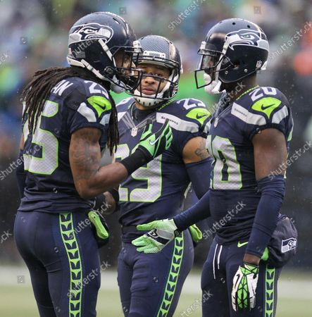 Seattle Seahawks officially released defensive backs, Richard Sherman (25) and Jeremy Lane (20) on March 9, 2018 in Seattle. In this 2015 file photo Richard Sherman (25), Earl Thomas (29), and Jeremy Lane (20) huddle together during their game against the St. Louis Rams at CenturyLink Field in Seattle, Washington on December 27, 2015.