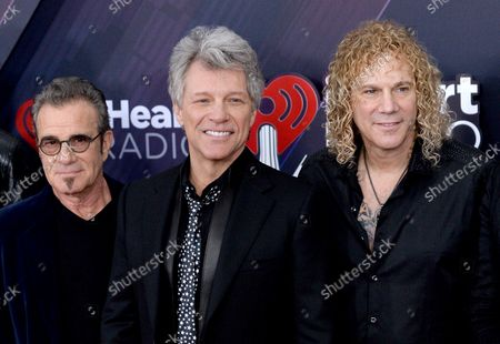 (L-R) Tico Torres, Jon Bon Jovi, and David Bryan of Bon Jovi arrive for the iHeartRadio Music Awards at The Forum in Inglewood, California on March 11, 2018. Turner's TBS, TNT, and truTV channels broadcasted the ceremony live from The Forum.