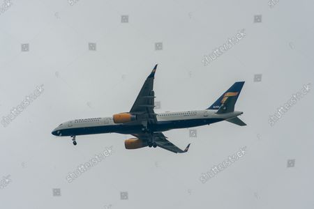 An IcelandAir Boeing 757-200 aircraft. It was a busy morning with aircraft arrivals coming into land at London Heathrow flying over Windsor. Michael O'Leary, Chief Executive of Ryanair has called for the Covid-19 Traffic Light System for passengers to be scrapped. The Government System has been criticised as it is causing confusion as to whether passengers need to self isolate