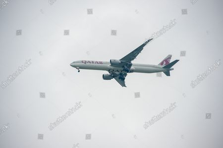 A Qatar Airways Boeing 777-300ER aircraft. It was a busy morning with aircraft arrivals coming into land at London Heathrow flying over Windsor. Michael O'Leary, Chief Executive of Ryanair has called for the Covid-19 Traffic Light System for passengers to be scrapped. The Government System has been criticised as it is causing confusion as to whether passengers need to self isolate