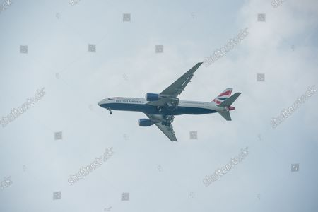 A British Airways Boeing 777-200 aircraft. It was a busy morning with aircraft arrivals coming into land at London Heathrow flying over Windsor. Michael O'Leary, Chief Executive of Ryanair has called for the Covid-19 Traffic Light System for passengers to be scrapped. The Government System has been criticised as it is causing confusion as to whether passengers need to self isolate