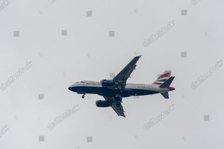 A British Airways Airbus A319-100 aircraft. It was a busy morning with aircraft arrivals coming into land at London Heathrow flying over Windsor. Michael O'Leary, Chief Executive of Ryanair has called for the Covid-19 Traffic Light System for passengers to be scrapped. The Government System has been criticised as it is causing confusion as to whether passengers need to self isolate