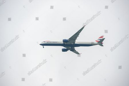 A British Airways Airbus A350-1000. It was a busy morning with aircraft arrivals coming into land at London Heathrow flying over Windsor. Michael O'Leary, Chief Executive of Ryanair has called for the Covid-19 Traffic Light System for passengers to be scrapped. The Government System has been criticised as it is causing confusion as to whether passengers need to self isolate