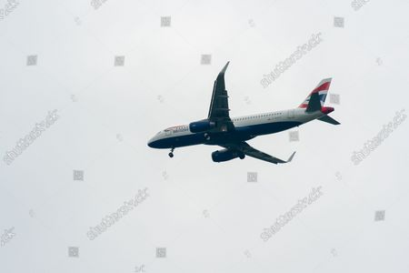 A British Airways Airbus A320-200 aircraft. It was a busy morning with aircraft arrivals coming into land at London Heathrow flying over Windsor. Michael O'Leary, Chief Executive of Ryanair has called for the Covid-19 Traffic Light System for passengers to be scrapped. The Government System has been criticised as it is causing confusion as to whether passengers need to self isolate
