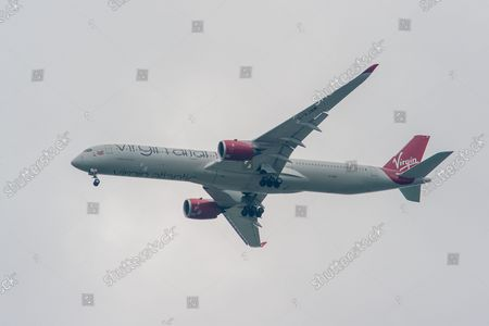 Stock Image of A Virgin Atlantic Airways Airbus A350-1000 aircraft. It was a busy morning with aircraft arrivals coming into land at London Heathrow flying over Windsor. Michael O'Leary, Chief Executive of Ryanair has called for the Covid-19 Traffic Light System for passengers to be scrapped. The Government System has been criticised as it is causing confusion as to whether passengers need to self isolate