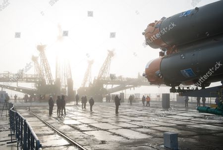 Workers are seen on the launch pad as the Soyuz rocket arrives after being rolled out by train, on March 19, 2018, at the Baikonur Cosmodrome in Kazakhstan. Expedition 55 crewmembers Ricky Arnold and Drew Feustel of NASA and Oleg Artemyev of Roscosmos are scheduled to launch at 1:44 p.m. Eastern time (11:44 p.m. Baikonur time) on March 21 and will spend the next five months living and working aboard the International Space Station. NASA