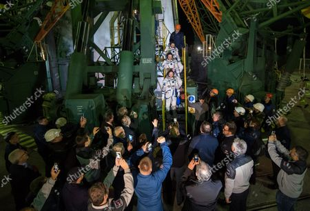Expedition 55 flight engineer Drew Feustel of NASA, top, flight engineer Ricky Arnold of NASA, middle, and Soyuz Commander Oleg Artemyev of Roscosmos, bottom, wave farewell prior to boarding the Soyuz MS-08 spacecraft for launch, on March 21, 2018, at the Baikonur Cosmodrome in Kazakhstan. Feustel, Arnold, and Artemyev will spend the next five months living and working aboard the International Space Station. NASA