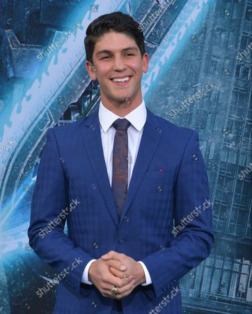 """Cast member Rahart Adams attends the premiere of the sci-fi motion picture """"Pacific Rim Uprising"""" at the TCL Chinese Theatre in the Hollywood section of Los Angeles on March 21, 2018. Storyline: Jake Pentecost, son of Stacker Pentecost, reunites with Mako Mori to lead a new generation of Jaeger pilots, including rival Lambert and 15-year-old hacker Amara, against a new Kaiju threat."""