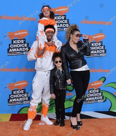 Stock Image of Mariah Carey and Nick Cannon arrive with their children Moroccan Scott Cannon (in orange) and Monroe Cannon (black jacket) at the 31st annual Nickelodeon Kids' Choice Awards at The Forum in Inglewood, California on March 24, 2018.