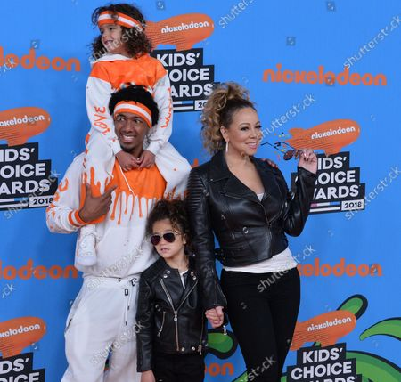 Mariah Carey and Nick Cannon arrive with their children Moroccan Scott Cannon (in orange) and Monroe Cannon (black jacket) at the 31st annual Nickelodeon Kids' Choice Awards at The Forum in Inglewood, California on March 24, 2018.
