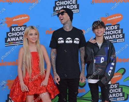 Travis Barker (C) and his daughter Alabama Luella Barker (L) and son Landon Asher Barker arrive for the 31st annual Nickelodeon Kids' Choice Awards at the Forum in Inglewood, California on March 24, 2018.