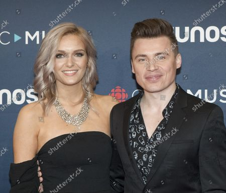 Stock Picture of Shawn Hook and date arrive on the red carpet at the 2018 JUNO Broadcast Awards in Vancouver, British Columbia, March 25, 2018.