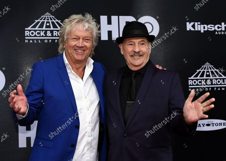 John Lodge (L) and Mike Pinder of Moody Blues pose for a photo on the red carpet at the 33rd annual Rock and Roll Hall of Fame induction ceremonies at Public Hall on April 14, 2018 in Cleveland Ohio. Bon Jovi, the Cars and four first-time nominees, including Nina Simone, will be inducted Saturday night as the 2018 Rock & Roll Hall of Fame class.