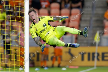 Portland Timbers goalkeeper Steve Clark, reacts as he comes down after a save against the Houston Dynamo during the second half of an MLS soccer match, in Houston