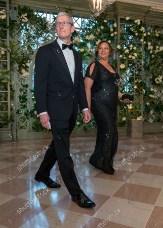 Tim Cook, Apple CEO, and Lisa Jackson arrive for the State dinner in honor of French President Emmanuel Macron and his wife Brigitte at the White House in Washington, D.C. on April 24, 2018. Macron and Trump met earlier in the day and discussed a range of bilateral issues during Trumps first official state visit with the French president.