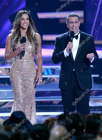 Gaby Espino (L) and Marco Antonio Regil speak onstage during the 2018 Billboard Latin Music Awards at the Mandalay Bay Events Center in Las Vegas, Nevada on April 26, 2018.