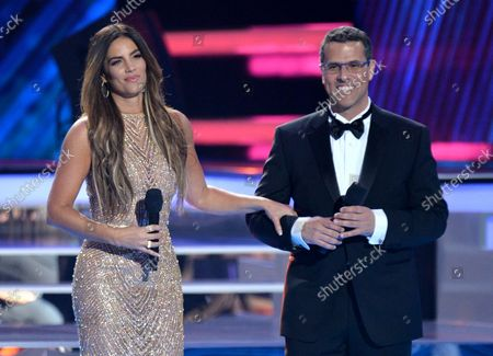 Stock Picture of Gaby Espino (L) and Marco Antonio Regil speak onstage during the 2018 Billboard Latin Music Awards at the Mandalay Bay Events Center in Las Vegas, Nevada on April 26, 2018.