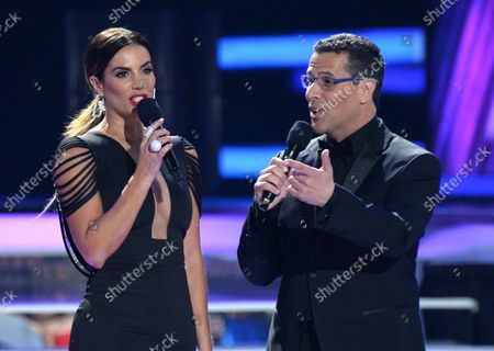 Stock Photo of Gaby Espino (L) and Marco Antonio Regil speak onstage during the 2018 Billboard Latin Music Awards at the Mandalay Bay Events Center in Las Vegas, Nevada on April 26, 2018.