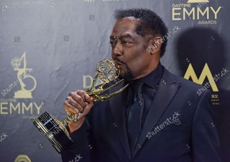 James Reynolds kisses his award for Outstanding Lead Actor in a Drama Series backstage in the press room during the 45th Annual Daytime Emmy Awards at the Pasadena Civic Auditorium in Pasadena, California on April 29, 2018.