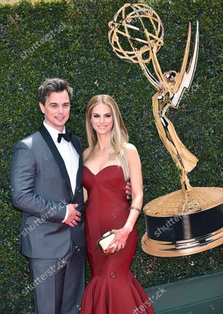 Darin Brooks (L) and Kelly Kruger arrive on the red carpet for the 45th Annual Daytime Emmy Awards at the Pasadena Civic Auditorium in Pasadena, California on April 29, 2018.