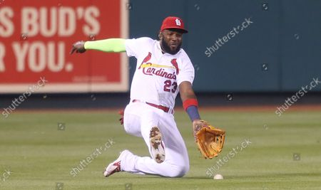 St. Louis Cardinals Marcell Ozuna tries to make a sliding catch on a ball off the bat of Chicago White Sox Yoan Moncada in the fourth inning at Busch Stadium in St. Louis on May 1, 2018. The ball got past Ozuna and rolled to the wall resulting in a two RBI double for Moncada.
