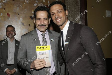 Tony Shalhoub holds a Playbill when he arrives with Ari'el Stachel on the red carpet at the 2018 Tony Awards Meet The Nominees Press Junket at the InterContinental New York Times Square Hotel on May 2, 2018 in New York City.