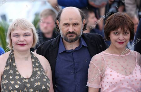 """Sveltana Kolesova (L), Valeriu Andriuta (C) and Natalja Buzco arrive at a photocall for the film """"Donbass"""" during the 71st annual Cannes International Film Festival in Cannes, France on May 9, 2018."""