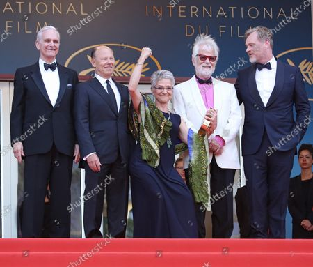 """Stock Photo of (From L to R) Keir Dullea, guest, Stanley Kubrick's daughter Katharina Kubrick, Stanley Kubrick's producing partner Jan Harlan and Christopher Nolan arrive on the red carpet before the screening of the film """"Sink Or Swim (Le grand bain)"""" at the 71st annual Cannes International Film Festival in Cannes, France on May 13, 2018."""