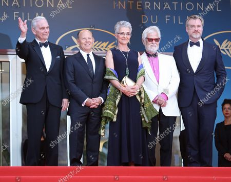 """Stock Image of (From L to R) Keir Dullea, guest, Stanley Kubrick's daughter Katharina Kubrick, Stanley Kubrick's producing partner Jan Harlan and Christopher Nolan arrive on the red carpet before the screening of the film """"Sink Or Swim (Le grand bain)"""" at the 71st annual Cannes International Film Festival in Cannes, France on May 13, 2018."""