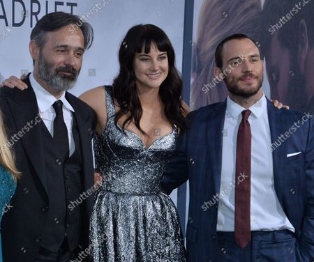 """Stock Picture of Director Baltasar Kormakur joins cast members Shailene Woodley and Sam Claflin (L-R) during the premiere of the motion picture romantic thriller """"Adrift"""" at the Real Cinema LA Live in Los Angeles on May 23, 2018. Storyline: Based on the true story of survival, a young couple's chance encounter leads them first to love, and then on the adventure of a lifetime as they face one of the most catastrophic hurricanes in recorded history."""