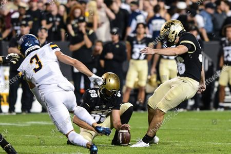 Stock Picture of Colorado Buffaloes place kicker Cole Becker (36) attempts a 53-yard field goal in the football game between Colorado and Northern Colorado at Folsom Field in Boulder, CO. It hit the cross bar and up short but Colorado defeated Northern Colorado 35-7