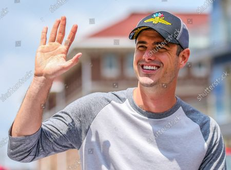 Bachelor Star Ben Higgins waves during the the 2018 Indianapolis 500 Festival Parade  on May 26, 2018 in Indianapolis, Indiana.