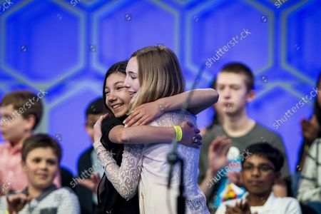Melodie Loya, 13, from Bainbridge, New York, hugs her best friend, Phoebe Smith, 12, from Aston, Pennsylvania, after Smith was eliminated in the final round of the 2018 Scripps National Spelling Bee on May 31, 2018 in Oxon Hill, Maryland. The Bee was expanded this year and now spans three days with 519 spellers. Forty-one spellers advanced to the final round.