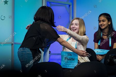 Melodie Loya, 13, from Bainbridge, New York, hugs her best friend. Phoebe Smith, 12, from Aston, Pennsylvania, during the final round of the 2018 Scripps National Spelling Bee on May 31, 2018 in Oxon Hill, Maryland. The Bee was expanded this year and now spans three days with 519 spellers. Forty-one spellers advanced to the final round.