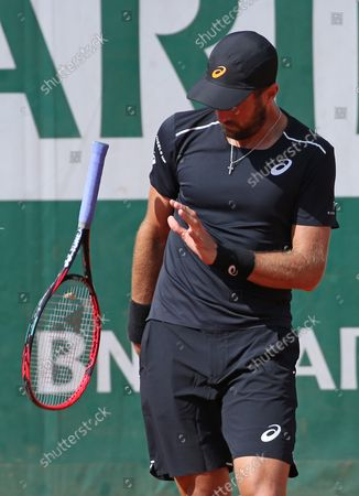 American Stevie Johnson watches his racket rebound after slamming it on the court during his French Open men's third round match against Marin Cilic of Croatia at Roland Garros in Paris on June 2, 2018. Cilic defeated Johnson 6-3, 6-2, 6-4 to advance to the fourth round.