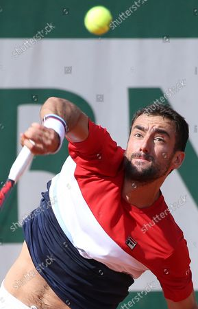 Marin Cilic of Croatia hits a serve during his French Open men's third round match against American Stevie Johnson at Roland Garros in Paris on June 2, 2018. Cilic defeated Johnson 6-3, 6-2, 6-4 to advance to the fourth round.