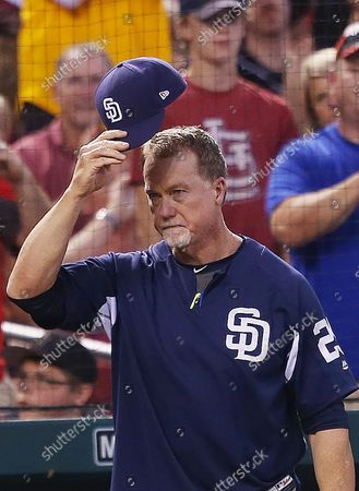 San Diego Padres bench coach Mark McGwire acknowledges the crowd after he is introduced during a game against the St. Louis Cardinals at Busch Stadium in St. Louis on June 13, 2018.McGwire broke the all time season high for home runs 20 years ago in 1998 as a member of the St. Louis Cardinals.