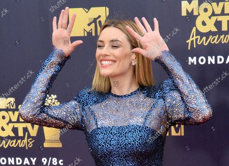 Actress Arielle Vandenberg attends the MTV Movie & TV Awards at the Barker Hangar in Santa Monica, California on June 16, 2018. It will be the 27th edition of the awards, and the second to jointly honor movies and television. The show will tape on Saturday, June 16th and air on Monday, June 18th.