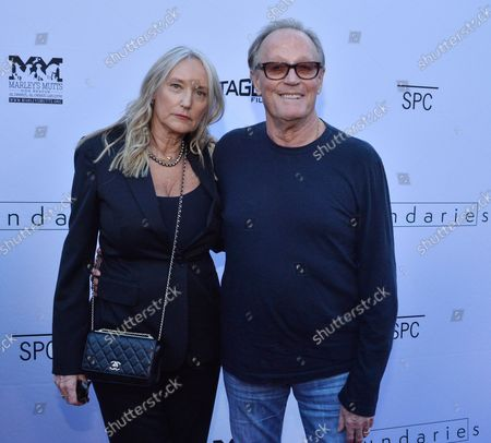 """Cast member Peter Fonda and his wife Margaret DeVogelaere attend the premiere of the motion picture dramatic comedy """"Boundaries"""" at the Egyptian Theatre in the Hollywood section of Los Angeles on June 19, 2018. The film tells the story of Laura and her son Henry, who are forced to drive her estranged care-free pot dealing father across country after he's kicked out of yet another nursing home."""