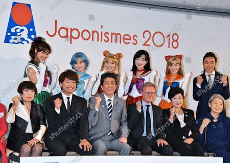 """Stock Photo of (Front, L-R)Designer Junko Koshino, Singer and actor Shingo Katori, Japan's Prime Minister Shinzo Abe, French Ambassador to Japan, Laurent Pic, Tokyo Governor Yuriko Koike and actress Kirin Kiki attend the send-off party for """"Japonism 2018: souls in harmony"""" in Tokyo, Japan on July 2, 2018. """"Japonism 2018: souls in harmony"""" are 160th anniversary event for establishment of diplomatic relations between France and Japan in 2018."""