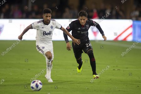 Stock Photo of Vancouver Whitecaps defender Sean Franklin (3) and D.C. United midfielder Ian Harkes (23) battle for a loose ball during the game between D.C. United and Vancouver Whitecaps at Audi Filed in Washington, DC on July 14, 2018. This is D.C. United's first game at the new field.