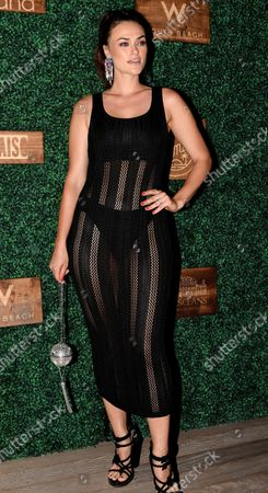 Myla Dalbesio walks the red carpet at the 2018 Sports Illustrated Swimsuit show at the W hotel in Miami Beach, Florida, July 15, 2018.