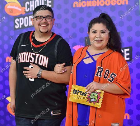 Rico Rodriguez (L) and his sister Raini Rodriguez attend Nickelodeon's KIds' Choice Sports Awards 2018 at Barker Hangar in Santa Monica, California on July 19, 2018.