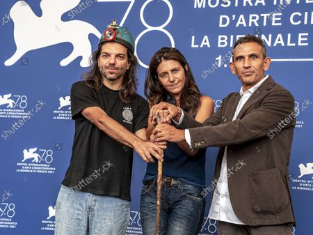 From left, speleologist Leonardo Zaccaro, screenwriter Giovanna Giuliani, and director Michelangelo Frammartino pose for photographers at the photo call for the film 'Il buco' (The hole) during the 78th edition of the Venice Film Festival in Venice, Italy
