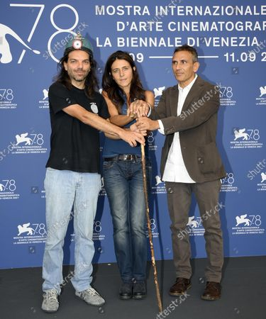 Michelangelo Frammartino (R), Italian screenwriter Giovanna Giuliani (C), and Italian speleologist Leonardo Zaccaro (L) pose at a photocall for 'Il Buco' during the 78th annual Venice International Film Festival,in Venice, Italy, 04 September 2021. The movie is presented in Official competition 'Venezia 78'at the festival running from 01 to 11 September.