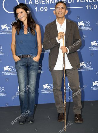 Michelangelo Frammartino (R) and Italian screenwriter Giovanna Giuliani (L) pose at a photocall for 'Il Buco' during the 78th annual Venice International Film Festival,in Venice, Italy, 04 September 2021. The movie is presented in Official competition 'Venezia 78'at the festival running from 01 to 11 September.