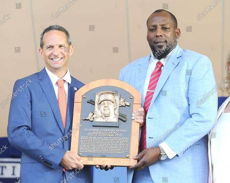 Vladmir Guerrero and President of the Baseball Hall of Fame Jeff Idelson holds his plaque before he delivers his  Baseball Hall of Fame induction speech at the Clark Sports Center in Cooperstown, NY on July 29, 2018.  A record 60 Hall of Famers are scheduled to be in Central New York to honor Vladimir Guerrero, Trevor Hoffman, Chipper Jones, Jack Morris, Jim Thome and Alan Trammell at the National Baseball Hall of Fame and Museum during Hall of Fame Weekend on July 27-30.