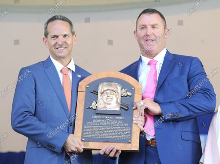 Jim Thome  and President of the Baseball Hall of Fame Jeff Idelson holds his plaque before he  delivers his Baseball Hall of Fame induction speech at the Clark Sports Center in Cooperstown, NY on July 29, 2018.  A record 60 Hall of Famers are scheduled to be in Central New York to honor Vladimir Guerrero, Trevor Hoffman, Chipper Jones, Jack Morris, Jim Thome and Alan Trammell at the National Baseball Hall of Fame and Museum during Hall of Fame Weekend on July 27-30.