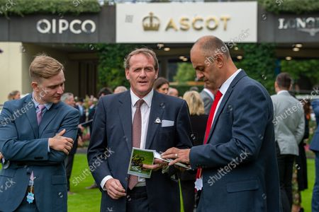Stock Image of Trainer Richard Hannon Jnr (middle) at Ascot Races