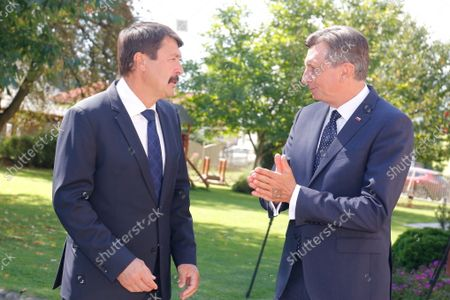 Hungarian President Janos Ader (L) and Slovenian President Borut Pahor attend a ceremony held to mark the 30th anniversary of the Slovenian Association in Hungary in Szentgotthard, Hungary, 04 September 2021.
